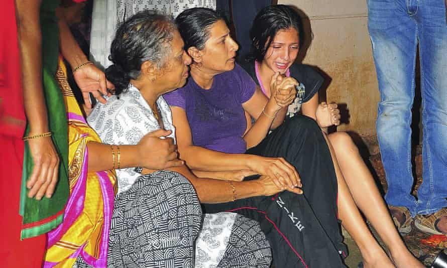 Unidentified relatives of senior journalist Gauri Lankesh cry at her residence in Bangalore, India.