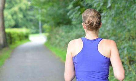 A woman running down a path