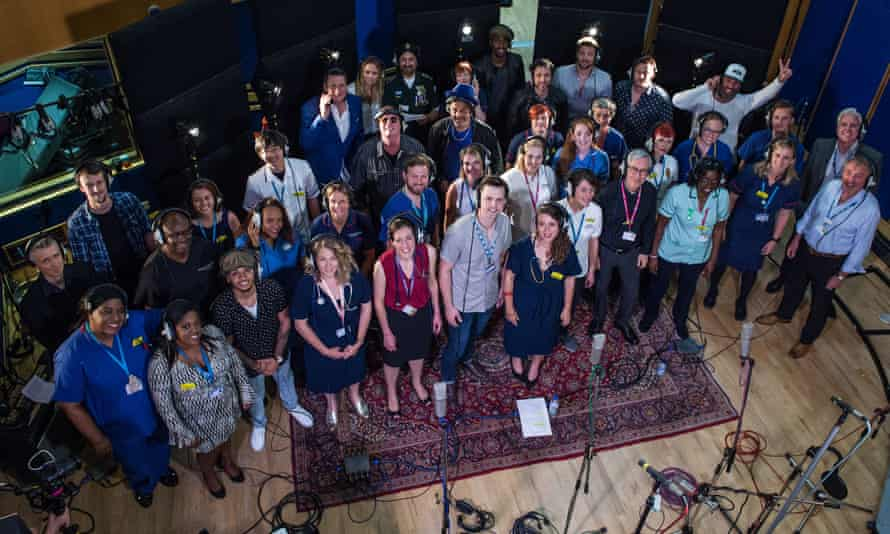 'We are doing it to boost morale' … the choir and stars.