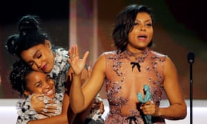 "Taraji P. Henson and Janelle Monae accept their award for Cast in a Motion Picture for ""Hidden Figures"" during the 23rd Screen Actors Guild Awards in Los Angeles."