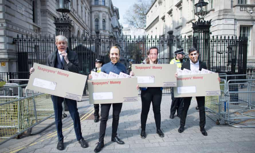 Labour activists wearing face masks of Boris Johnson, Matt Hancock, David Cameron and Rishi Sunak outside Downing Street to highlight Tory cronyism.