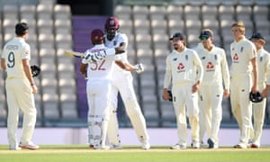 Jason Holder and John Campbell celebrate a hard-fought victory.