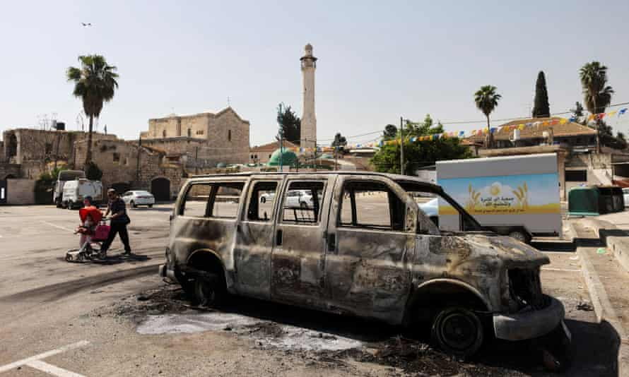 A burnt-out vehicle after violent confrontations in Lod.