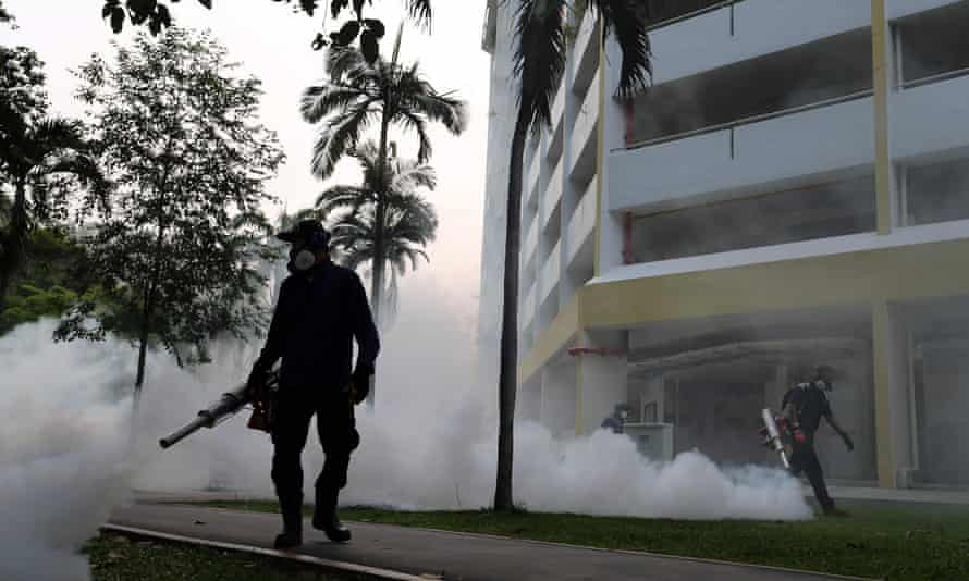 Workers fogging the housing estate at Aljunied Crescent in Singapore.