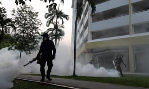 Workers use fogging equipment at a housing estate in Aljunied Crescent, Singapore, in August
