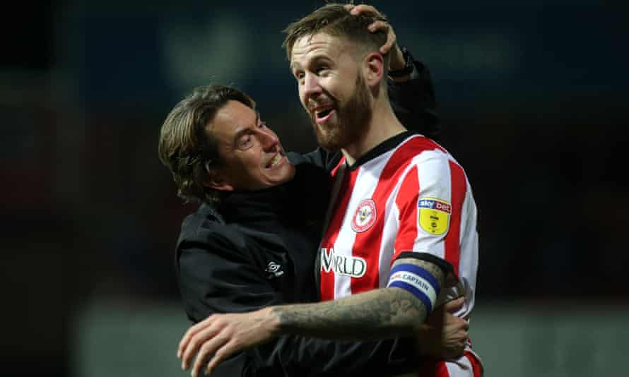 Thomas Frank celebrates victory over Cardiff with Pontus Jansson, who was the oldest outfield player Brentford signed in four years.