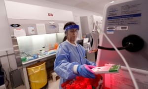 A medical technologist tests a respiratory panel at Northwell Health Labs, where the same test will be used on the Covid-19, in Lake Success, New York.