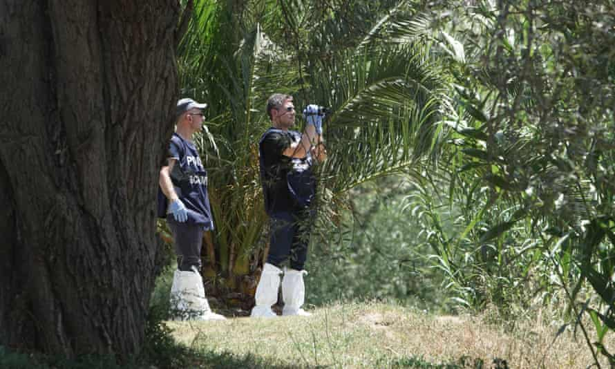 Forensic police scan the banks of the Tiber river in Rome where the body of a young man was found on Monday.