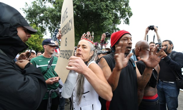 Counter-protesters debate with alt-right groups at Tom McCall Waterfront Park.