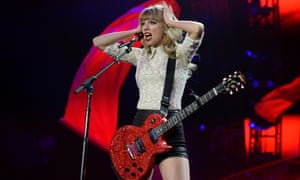 Taylor Swift performing in 2013 during the Denver leg of her Red Tour