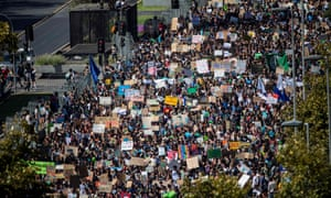 "Thousands take part in a protest called by the ""Fridays For Future"" movement on a global day of student protests aiming to spark world leaders into action on climate change in Santiago, Chile, on March 15, 2019."
