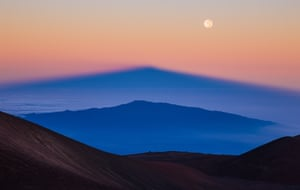 Parallel Mountains Sean Goebel (USA) The shadow of Manua Kea, the highest peak in the state of Hawaii, is projected by the rising sun over the volcano, Hualalai, whilst the full moon soars above them, higher again.