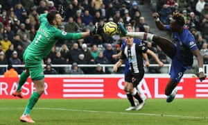 Chelsea's Tammy Abraham knocks the ball past Newcastle keeper Martin Dubravka.