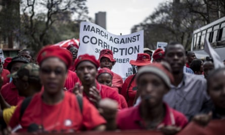 Economic Freedom Fighter supporters march along with thousands of anti-corruption activists in Petroria.