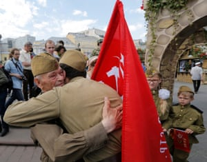 A young man thanks a veteran for his service during the war, in Red Square, Moscow
