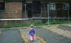 A young girl playing in a council estate in Bristol.