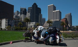San Francisco tower blocks look down on trolleys belonging to some of the city's homeless.
