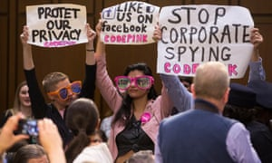 Protesters with signs at US senate's joint hearing into 'Facebook, Social Media Privacy, and the Use and Abuse of Data'