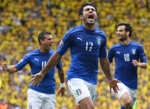 Éder (centre) celebrates scoring Italy's winner against a backdrop of despondent Swedish fans
