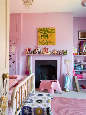 Sweet dreams: pink walls in their daughter's bedroom, with a painting by Hughes.