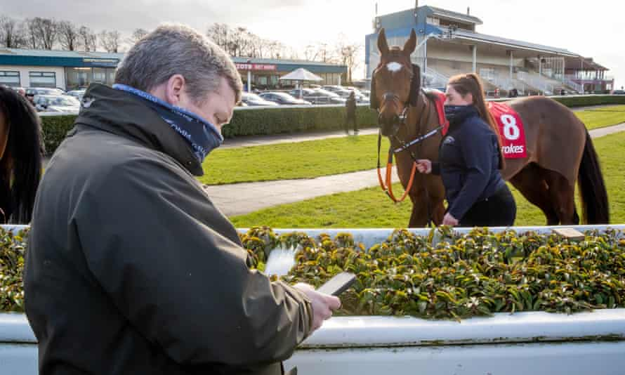 Gordon Elliott pictured alongside Tiger Roll, the horse he has trained to two Grand National wins.