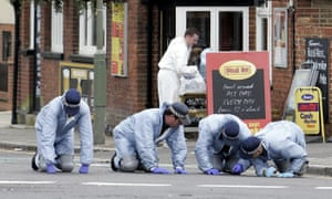 2005 photo of police forensics team searching the scene where armed police shot Azelle Rodney.