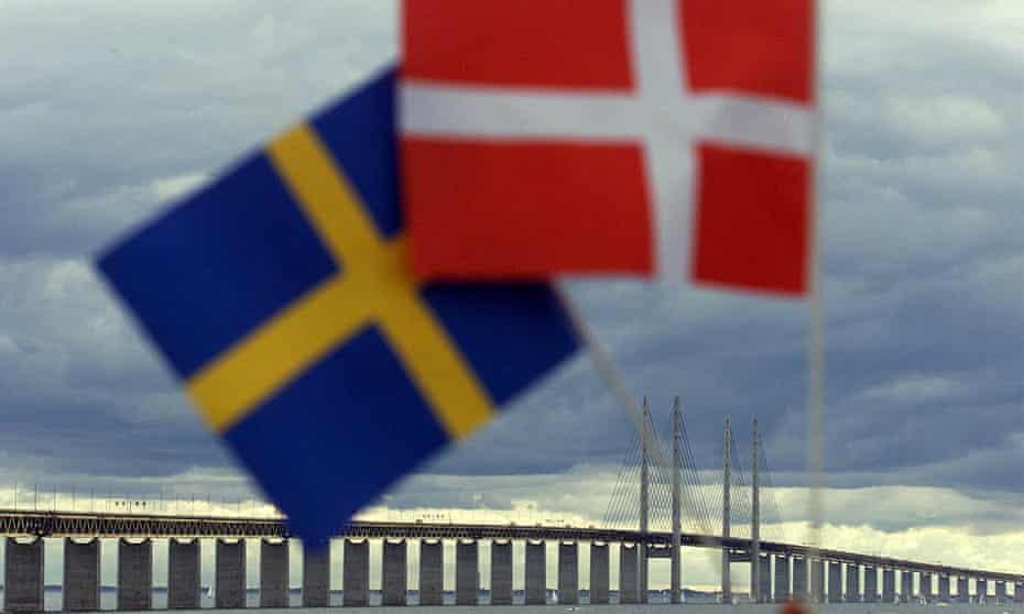 Swedish and Danish flags near the Oresund (Öresund in Swedish, or Øresund in Danish) Bridge.