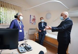 Sajid Javid, the health secretary (right) with Dr Clementine Olenga-Disashi (left) and Dr Ali al-Bassam, during a visit today to the Vale Medical Centre in Forest Hill, south east London.