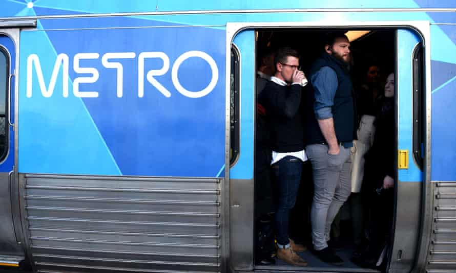 Commuters crammed on to a train in Melbourne. The 2019 Australian federal budget pledges billions for improved rail services.
