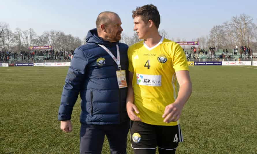 Real Kashmir's coach David Robertson and his son and player Mason Robertson walk after winning their I-League club football match against Chennai City FC.