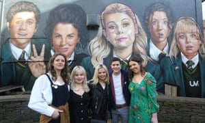 The cast of Derry Girls visit the mural at Badger's Bar, Derry.
