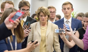 Senator Lisa Murkowski is surrounded by reporters as she arrives in the US Capitol prior to a vote on the repeal of the Affordable Care Act.