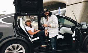 Passengers Whitney and Julius in the Tesla