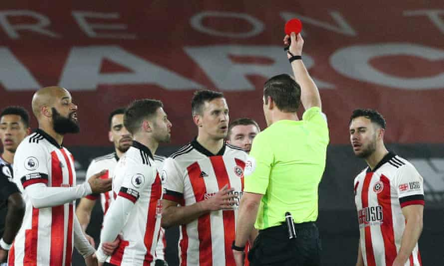 Robert Jones shows Sheffield United's Phil Jagielka the red card, after initially showing yellow before a VAR review