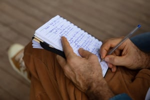 Anthropologist Marcelo Piedrafita takes notes during the meeting.