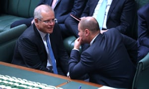 Prime minister Scott Morrison talks to treasurer Josh Frydenberg. The Coalition government needs four crucial Senate votes to pass its 2019 income tax cuts package on Thursday.