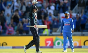 England's Joe Root drops his bat in celebration after reaching his century, hitting a four on the day's final ball.