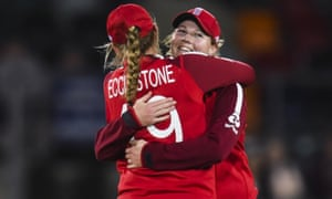 Anya Shrubsole is congratulated by teammate Sophie Ecclestone after claiming the wicket of Diana Baig of Pakistan.