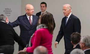 """US Vice President Joe Biden (R) is welcomed by founder and executive chairman Klaus Schwab prior to a session """"Cancer Moonshot: A Call to action"""" during the opening of the World Economic Forum (WEF) annual meeting in Davos, on January 19, 2016."""