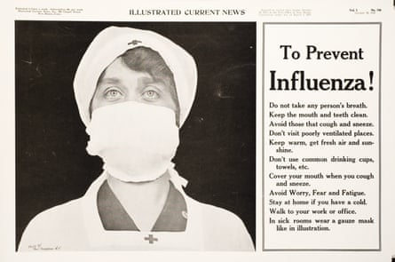 A Red Cross nurse with a gauze mask over her nose and mouth, 1918.