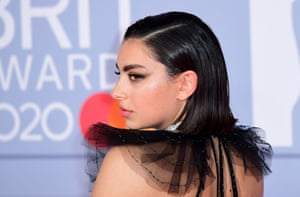 Charli XCX, nominee for best British female solo artist, arrives on the red carpet.