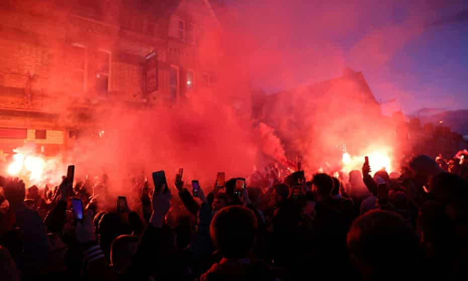 Liverpool fans let off flares outside the stadium before the match.