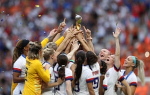 The US team celebrate with the Women's World Cup trophy after beating the Netherlands at Stade de Lyon.