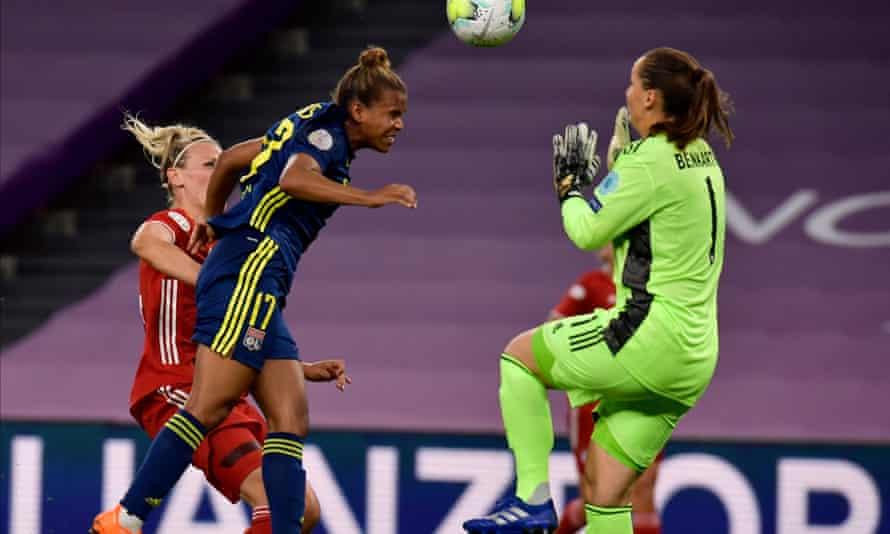 Lyon's Nikita Parris scores before being baulked by Bayern goalkeeper Laura Benkarth.