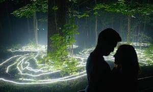 Moscow, Russia A couple enjoy a light show