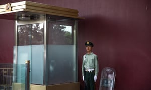 A Chinese People's Liberation Army soldier stands guard near Tiananmen Square in Beijing, China