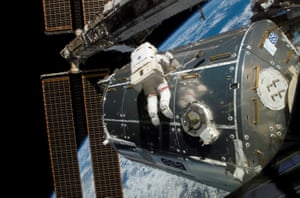 Astronaut Rex Walheim working on the exterior of the International Space Station