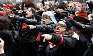 Women with blindfolds protest in front of the New York City criminal court on 10 January.