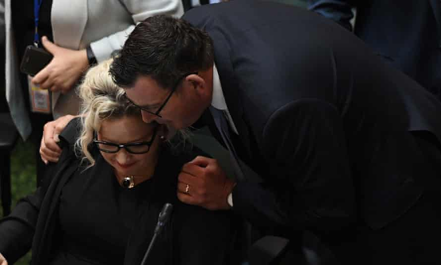 Daniel Andrews embraces health minister Jill Hennessy after the bill passes.