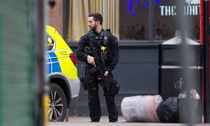 An armed police officer on Streatham High Road